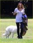 Miley Cyrus & Liam Hemsworth enjoy a romantic day at the park with their dog.